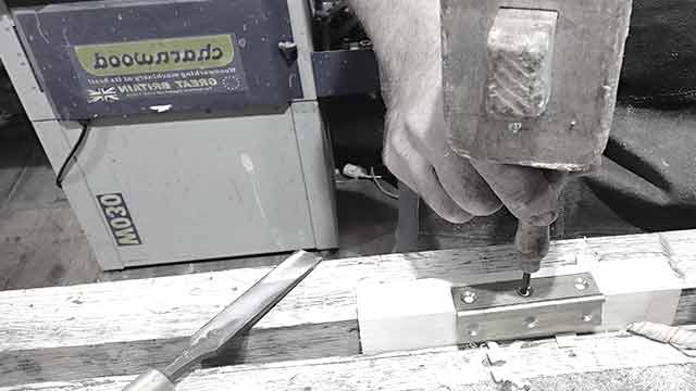 using a bradawl to pilot hole for screws in the hinge